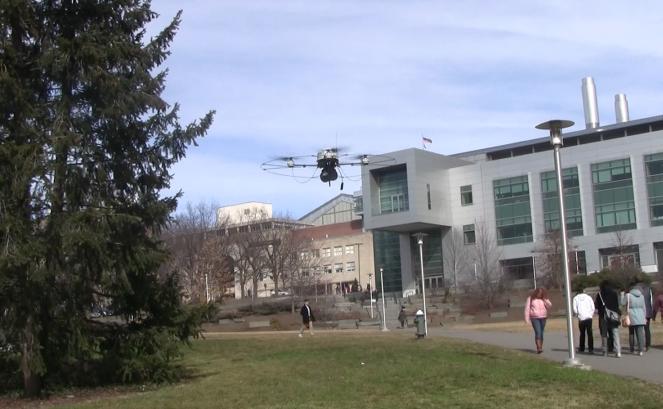 Obstacle avoiding flying robot
