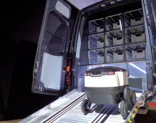 Integrating self-driving robots with delivery vans to provide local delivery